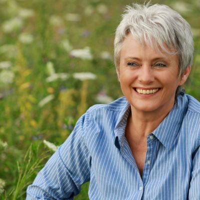resizeCanva - Happy attractive senior woman in a flowerfield